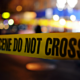 photo of crime scene tape and lights at night
