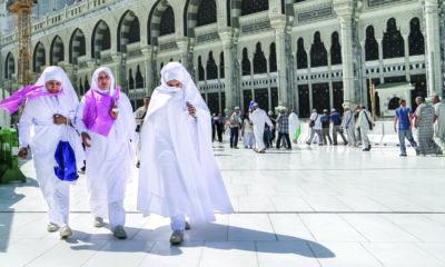 Women in Saudi Arabia walk through city.