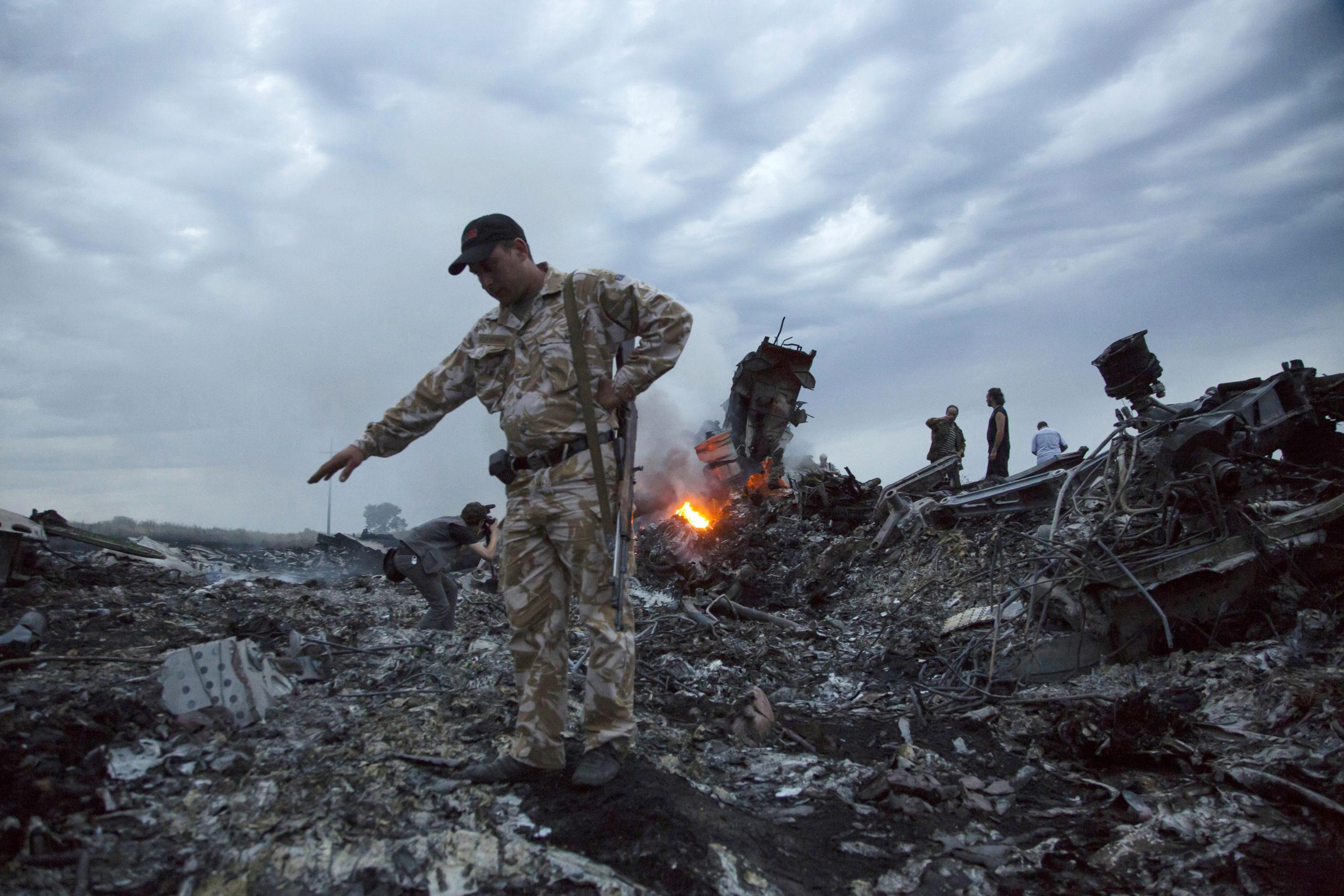 Debris at the crash site of a passenger plane near the village of Grabovo, Ukraine..