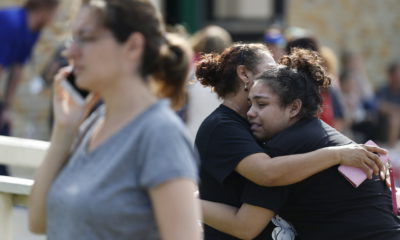 Santa Fe High School junior Guadalupe Sanchez cries in the arms of her mother, Elida Sanchez.