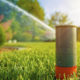 Home lawn sprinkler spraying water