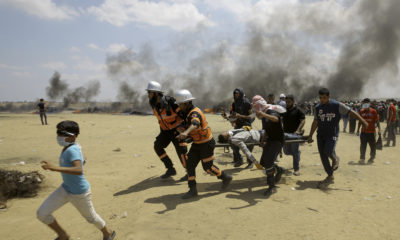 Palestinian medics evacuate victims