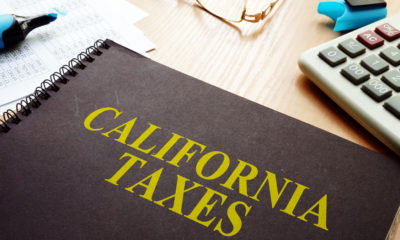 """Picture of a ledger on a desk. The ledger is titled """"California Taxes."""""""