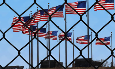 Picture of American flags at U.S.-Mexico border.