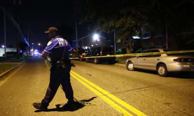 Photo of a police spreading crime tape