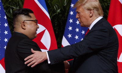 Photo of North Korea's Kim Jong Un and President Trump shaking hands