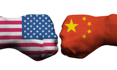 Boxing gloves featuring U.S., left, and China flags