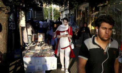 Photo of people walking in downtown Tehran, Iran.