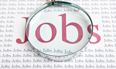 """Illustration of the word """"Jobs"""" under a magnifying glass"""