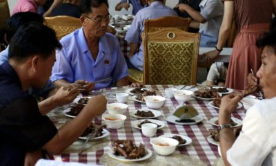Photo of men in North Korea eating dishes made with dog meat