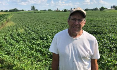 Photo of Farmer Michael Slattery standing in front of his soybean field