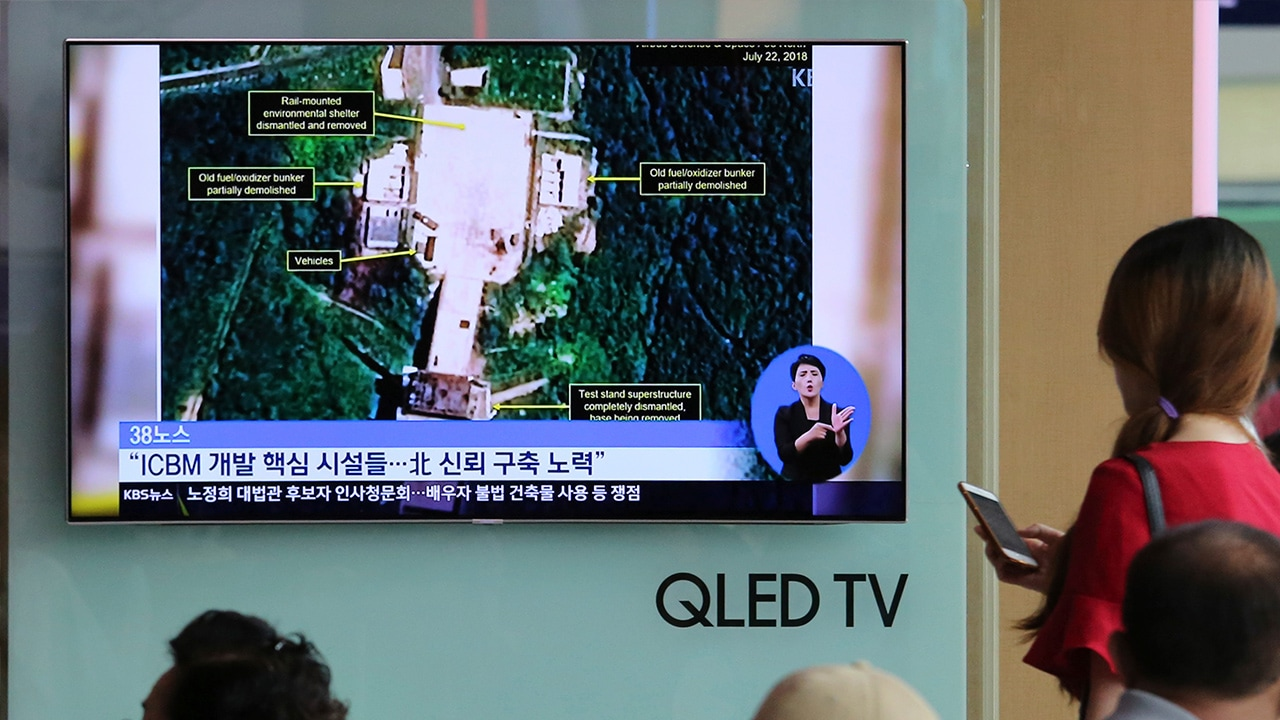 Photo of TV screen showing a satellite image of North Korea's Sohae launch site