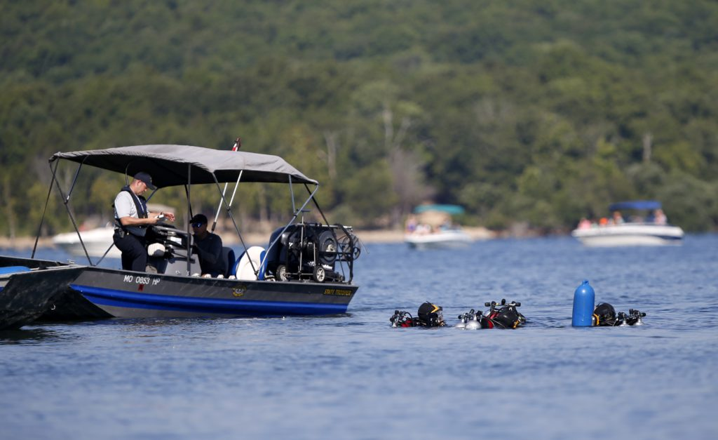 Photo of divers going to retrieve the duck boat that sank in Branson, Mo.