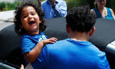Child reuniting with his father after being released from ICE