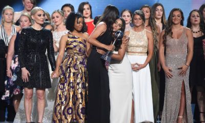 Photo of 140 survivors of sexual abuse receiving the Award for Courage at the ESPYs