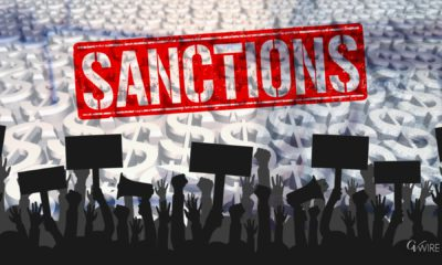 Image of dollar signs and people in the street, signifying the impacts of sanctons,