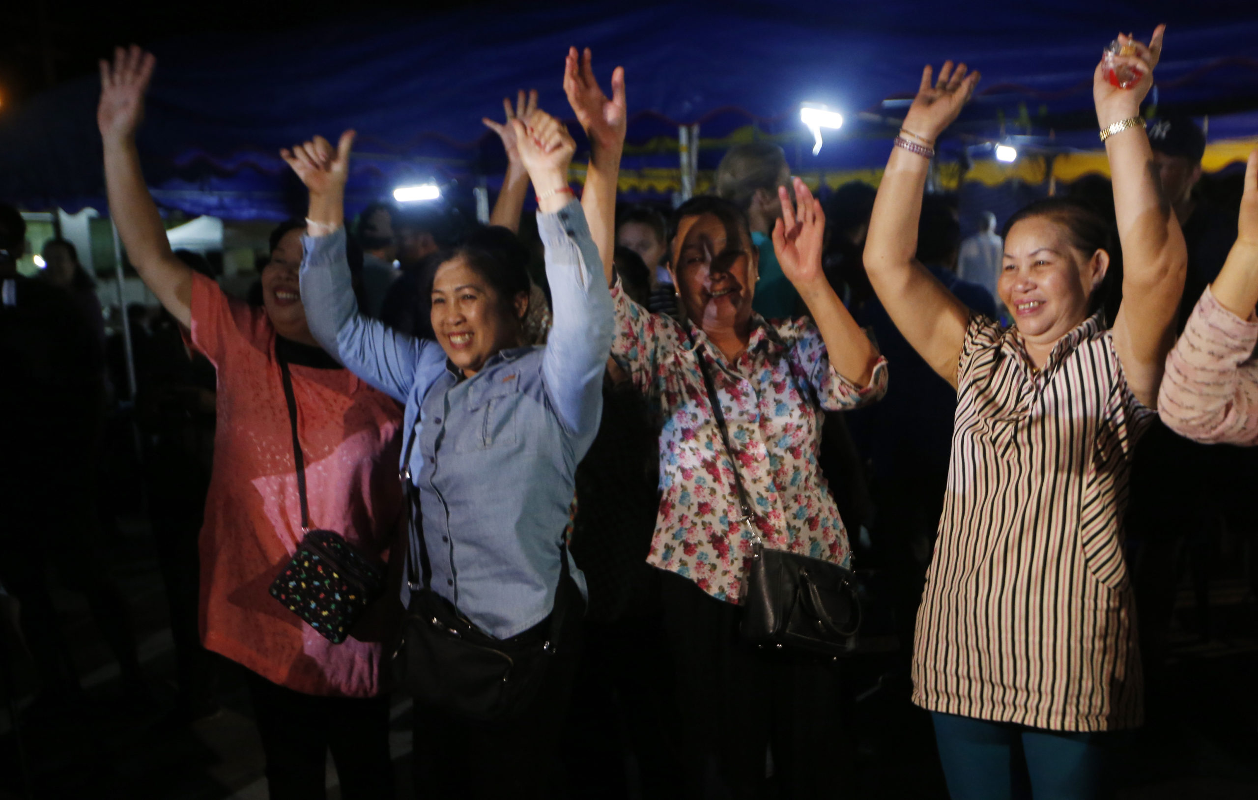 Photo of people celebrating the rescue of some of the boys from the Thai soccer team