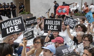 "AP photo of activists carrying ""Abolish I.C.E."" signs"