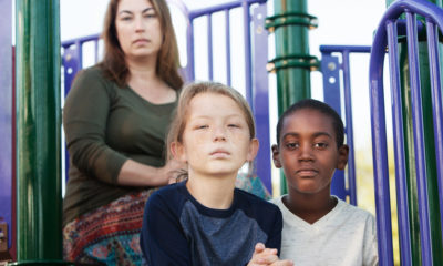 Shutterstock Photo of a mother with her daughter and a foster ston
