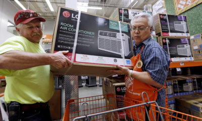 Picture of a man buying a room air conditioner in Seattle.