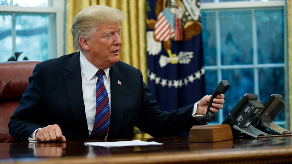 Photo of Donald Trump holding a phone