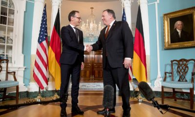 Photo of Secretary of State Mike Pompeo shaking hands with German Foreign Minister Heiko Maas