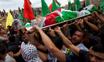 Photo of mourners carrying the dead body of Palestinian teen Nadim Nuwara
