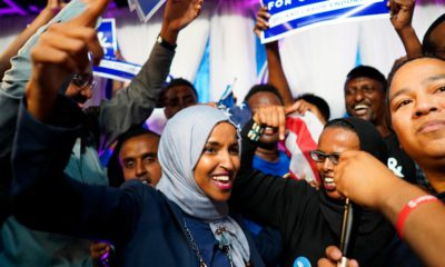 Photo of Minnesota Rep. Ilhan Omar celebrating with her supporters