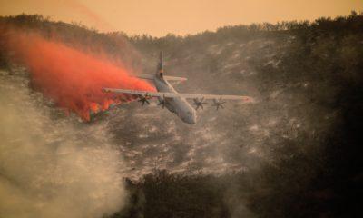Photo of C 1 30 aircraft dropping flame retardant over Santa Barbara fire in 2017