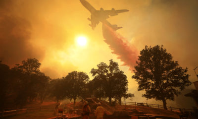 Photo of a 747 air tanker dropping fire retardant in Lakeport, Calif.