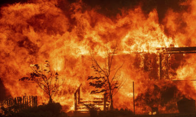 Photo of the River Fire consuming a home