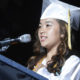 Fresno Unified School District Graduate in cap and gown speaking at commencement.