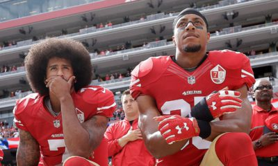 Photo of San Francisco 49ers quarterback Colin Kaepernick, left, and safety Eric Reid