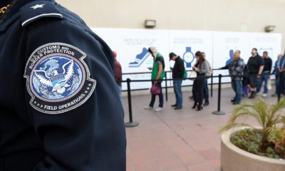 Photo of people crossing from Mexico into the U.S. in San Diego