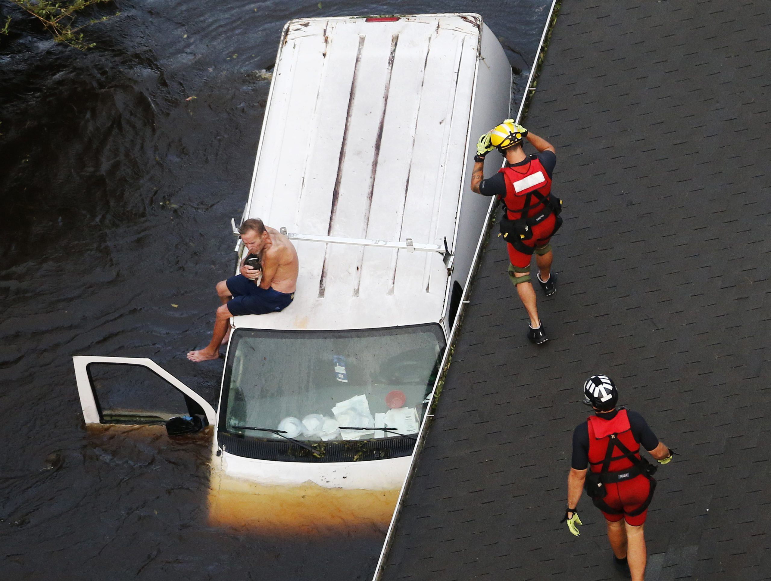 Photo of rescue team saving a man from flooding during Hurricane Florence