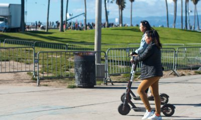 Photo of two girls riding motorized scooters in Venice