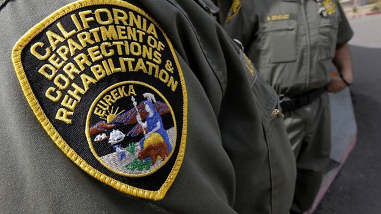 Photo of California Department of Corrections patch on correctional officer's uniform