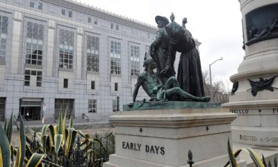 """Photo of """"Early Days"""" - a statue that depicts a Native American at the feet of a Spanish cowboy and Catholic missionary in San Francisco."""
