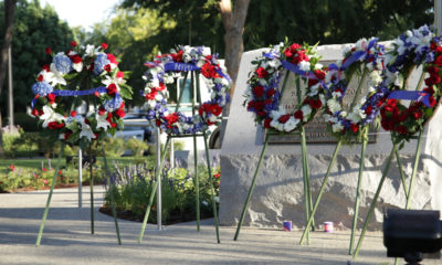 Photo of wreaths and memorial marker in Clovis, California, commemorating the 9-11 terrorist attacks