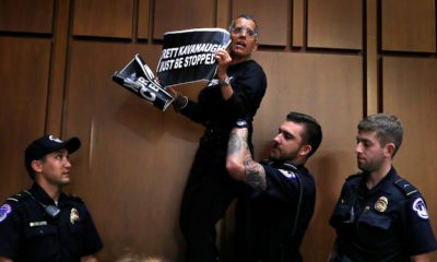 A protester is lifted off of a chair by U.S. Capitol Police