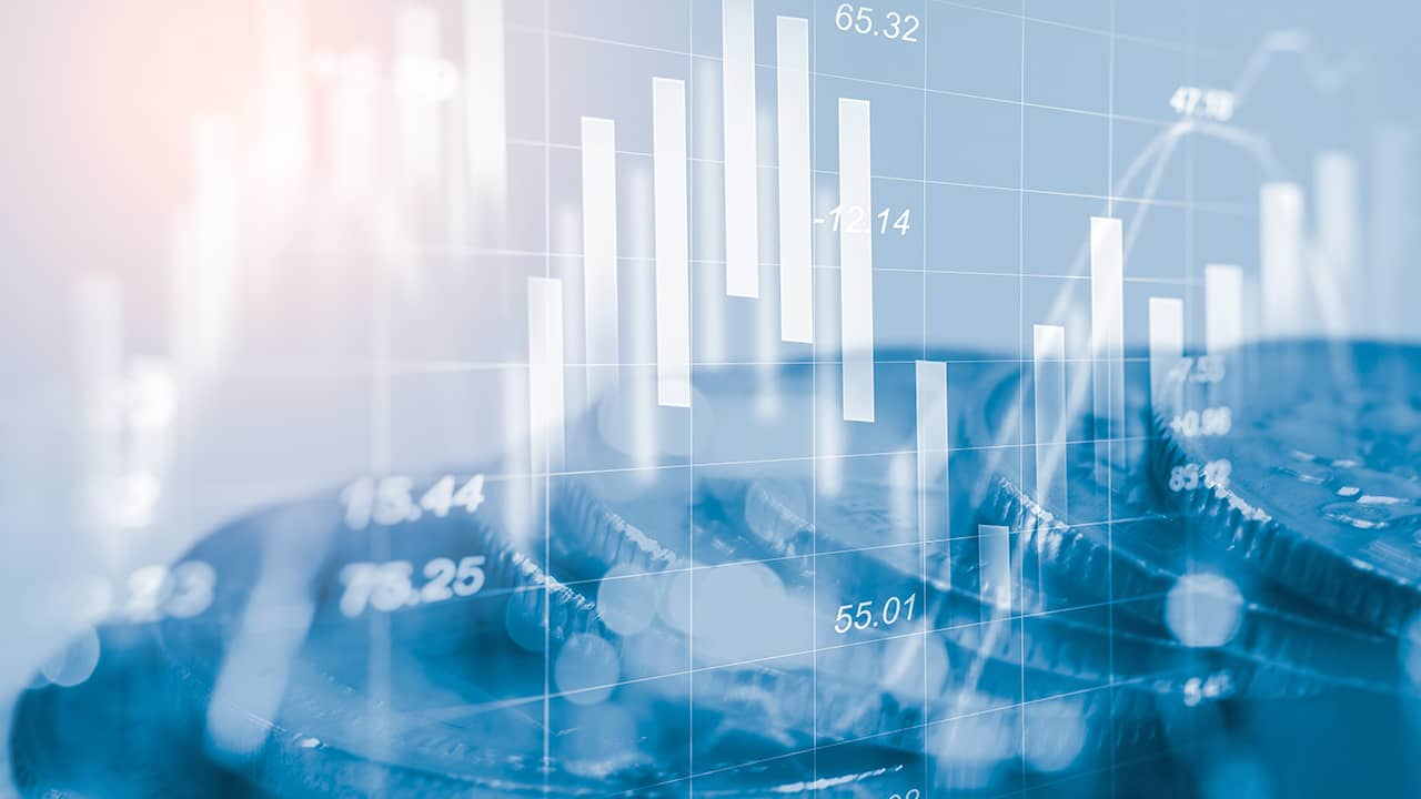 Stock photo of economy charts and coins