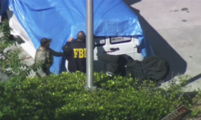 Photo of agents covering a van