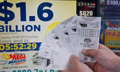 Photo of customer holding Mega Millions lottery tickets in Oklahoma City