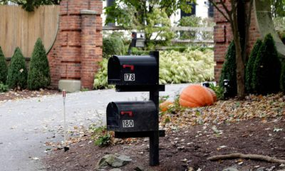 Photo of mailboxes stand outside the entrance to a house owned by philanthropist George Soros