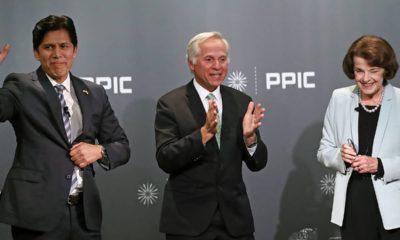 Photo of Kevin de Leon, debate monitor Mark Baldassare, and Dianne Feinstein