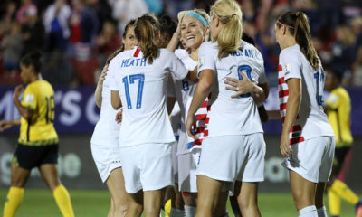 Photo of US Women's Soccer Team celebrating after win over Jamaica