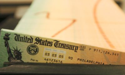 Photo of trays of printed social security checks