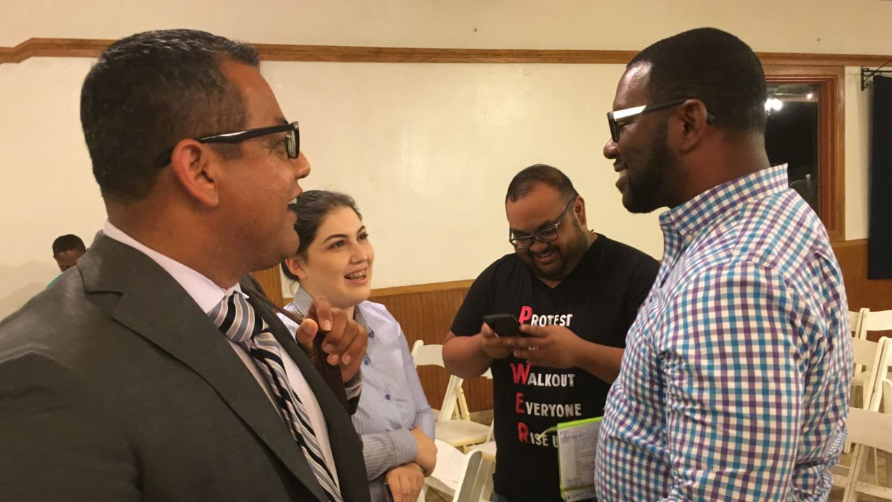 Miguel Arias and Tate Hill talk with voters after a District 3 candidate forum.