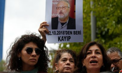 Photo of activists protesting with photos of missing Saudi journalist Jamal Khashoggi