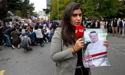Photo of journalist holding a poster of missing Saudi writer Jamal Khashoggi